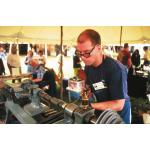 Photo of Jon Gibson Turning Pewter at Sunapee Fair